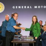 United Auto Workers President Gary Jones (left), and General Motors Chairman and CEO Mary Barra shake hands to open contract negotiations Tuesday, July 16, 2019 at the Marriott Hotel in Detroit, Michigan. (Photo by John F. Martin for General Motors)