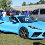 Corvette chief engineer Tadge Juechter driving the Rapid Blue C8 Corvette with Harlan Charles, Corvette & Camaro Marketing and Product Manager at the 2019 Corvettes at Carlisle